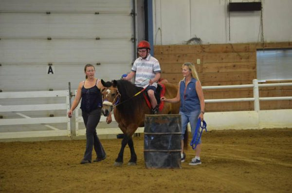Mr. Bolander with Little Joe Horse Gear hippotherapy saddle