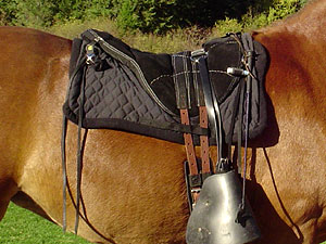Little Joe Horse Gear standard saddle blanket. This LittteJoe saddle has been customized by the rider with the addition of saddle strings and stirrup covers.